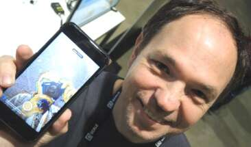 Developer Fabio Riccardi shows Facebook's inference software running on his iPhone. (Images: EE Times)